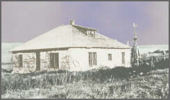 """The Monhart home, built in 1925, is shown here in the 1930s with """"gumbo mud"""" falling from the walls."""