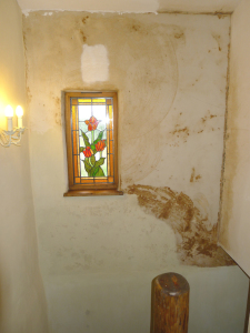 The effect of plastering too early; tanin stains on the plaster.