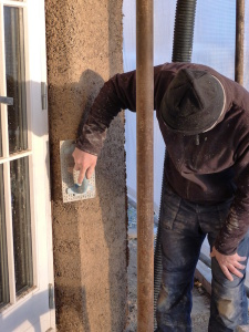 Using a nail float to soften a hempcrete corner 10 days after casting.