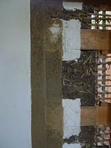 Structure of a traditional bamboo lattice and earthen plaster wall finished with shikkui lime plaster.